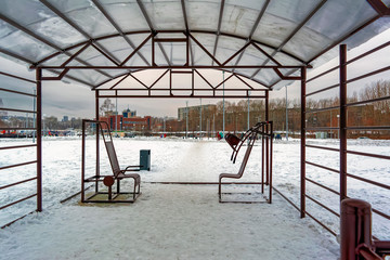 Street gym equipment in the park in winter
