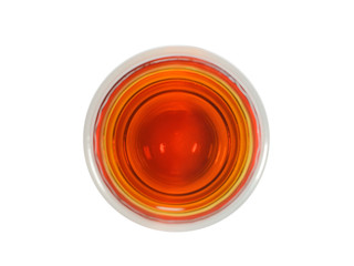 shot glass of whisky the top view on a white background