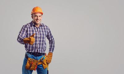 Fototapeta Repairman smiling in special clothes with tools. obraz