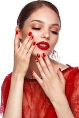 Beautiful girl in red dress with classic make-up and red manicure. Beauty face.