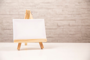 Miniature canvas on tripod stand