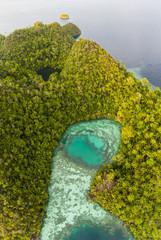 Aerial View of Lagoon, Marine Lake, and Limestone Island in Raja Ampat