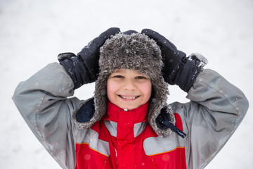 Portrait of smiling boy in winter clothes