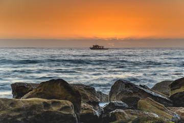 Fishing Boat, Rocks and a Sunrise Seascape