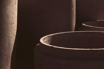 shadows on concrete tubes