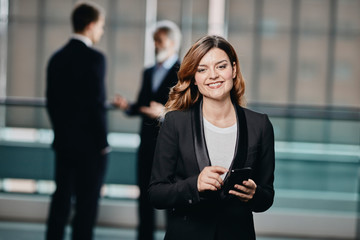 beautiful and successfull business woman in her 30´ in a corporate building