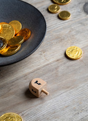 Dreidel game played with chocolate geltwood