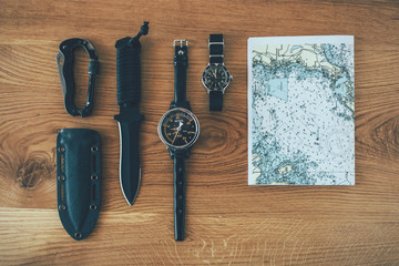 Diving equipment flat lay on wooden background