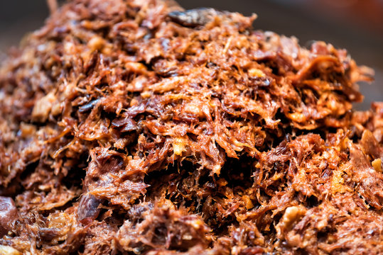 Shish kabob shredded pork barbeque bbq meat large beef pile in fast food truck counter showing macro closeup detail texture, red orange brown fresh color, pattern
