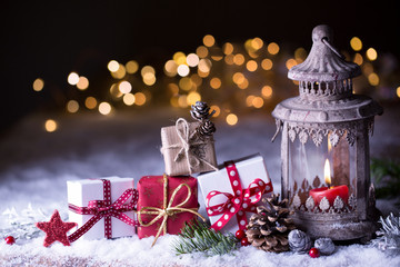 Christmas background  -  Lantern and gift boxes in snow landscape