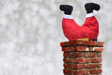 Santa Claus upsidedown in a chimney