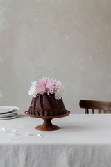 Chocolate cake decorated with fresh blossoms