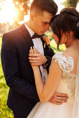 portrait of the bride and groom in nature, beautiful couple in love