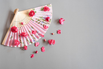 Paperfan Sprinkle with red flower, Chinese blow, Japanese fans, Wood blower, Ancient paper isolated on Gray background.