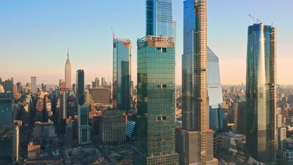 Fototapete - Aerial drone footage of New York skyline panning along Hudson Yards midtown Manhattan skyscrapers (some still being under construction)