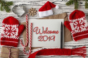 WELCOME 2019 handwritten inscription. Winter holiday composition. Top View.