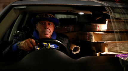 Anti-Brexit protester Steve Bray poses for a photograph as he sits in his car after a day of demonstrating outside the Houses of Parliament in London
