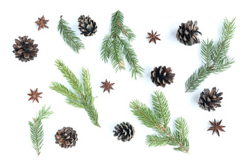 Christmas composition of fir branches, anise and cones isolated on white background.