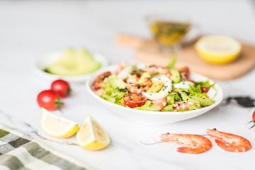 Fresh salad lying in white plate