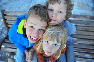 Three kids looking at camera