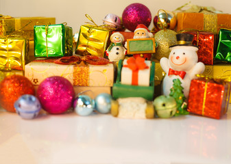 Santa Claus and snowman dolls deliver good kids gifts on Christmas eve, background with decorated Christmas present boxes, tree and baubles. Happy Special Holidays, Festival decoration, Celebration.