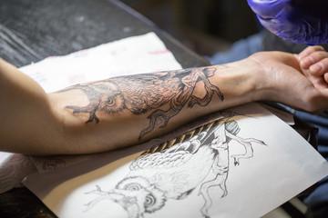 Owl tattoo on male hand