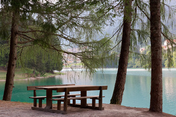 cozy place. table and bench by the lake.