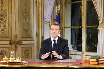 French President Emmanuel Macron speaks during a special address to the nation, his first public comments after four weeks of nationwide 'yellow vest' (gilet jaune) protests, at the Elysee Palace, in Paris