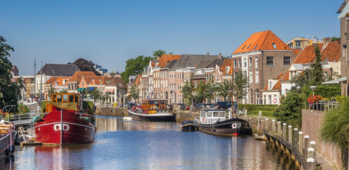 Panorama of a canal with old ships and historical houses in Zwolle Wall mural