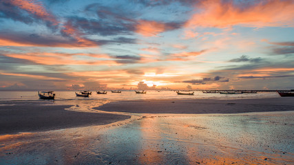 Aerial view beach sunset with fisherman boat at Phuket Thailand