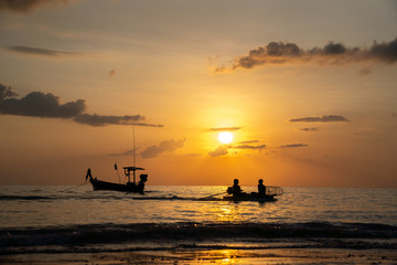 Fotobehang Schip Beach sunset and fisherman boat for commercial background