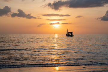 Beach sunset and fisherman boat for commercial background