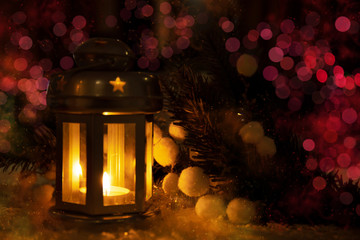 Christmas holidays background with candle lamp and bokeh.