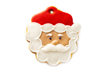 Closeup image of Santa Claus head gingerbread xmas cookie isolated at white background.