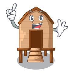 Finger chicken in a wooden cartoon coop