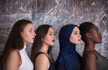 Portrait of four girls with different skin color and nationality in the studio