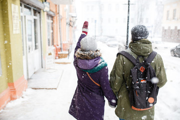 Happy Young Couple in Winter city having fun.