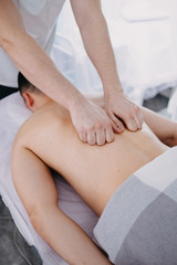 Sports massage. Therapist working with shoulders