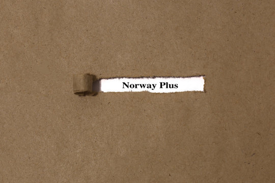 Ripped brown manilla envelope revealing the words Norway plus on white paper.  UK Brexit deal concept