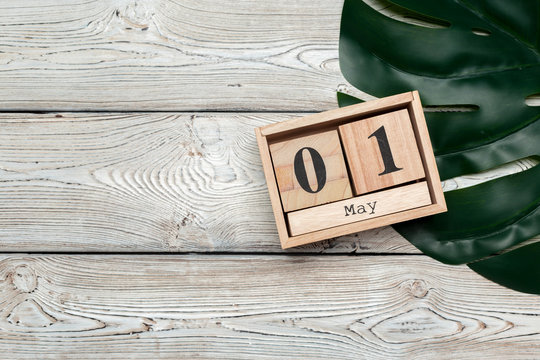 May 1st. Image of may 1 wooden color calendar on wooden background. Spring day, empty space for text. International Workers' Day