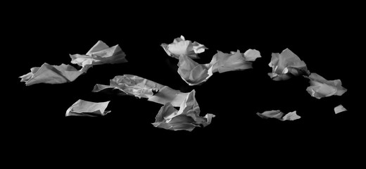 Crumpled and torn paper scraps isolated on black background