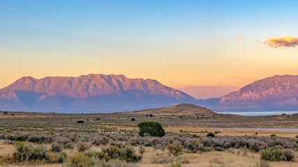 Utah Lake bordered by rugged terrain and mountains