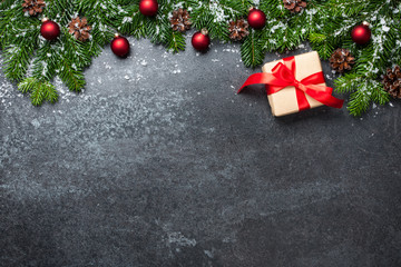 Christmas background with fir branches, gift box and decorations