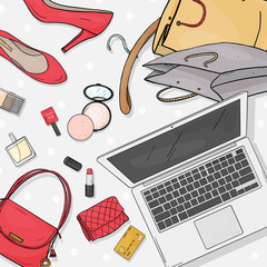 Online store desktop concept with laptop, Desk, bags, credit cards, cosmetics and shoes. Credit card payment. The view from the top.