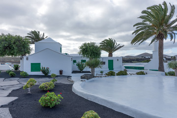 Street view of beautiful residential white and green house in Lanzarote, Canary Islands, Spain