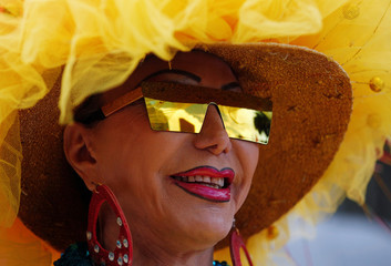 A reveller poses for a photograph during the Gay Pride Parade in Bogota