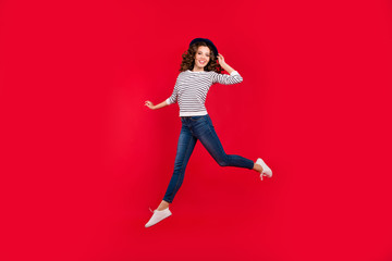 Full length size body photo of jumping high pretty charming she her girl raised arm with nice hat wearing white casual sweater on red vivid bright background