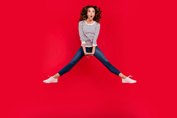 Full length size body photo of fly high pretty charming she her girl legs apart arms together wondered wearing striped white casual sweater on red vivid bright background
