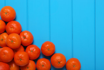 Tangerine on wood table background