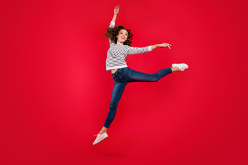 Full length size body photo of fly high attractive beautiful she her girl pretending like ballet dance queen wearing white casual sweater on red vivid bright background